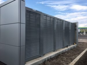 A great horizontal louvered equipment screen wall.