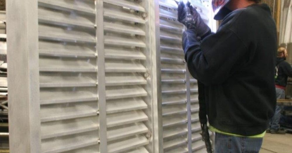 PalmSHIELD Louvers. Custom fabricated louvered screen system.