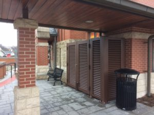 Brown horizontal louvers on an outdoor, red brick facility. A great choice for mechanical equipment enclosures.