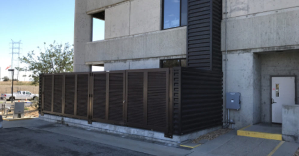 A brown louvered fence on the side of a building in sunny Los Angeles