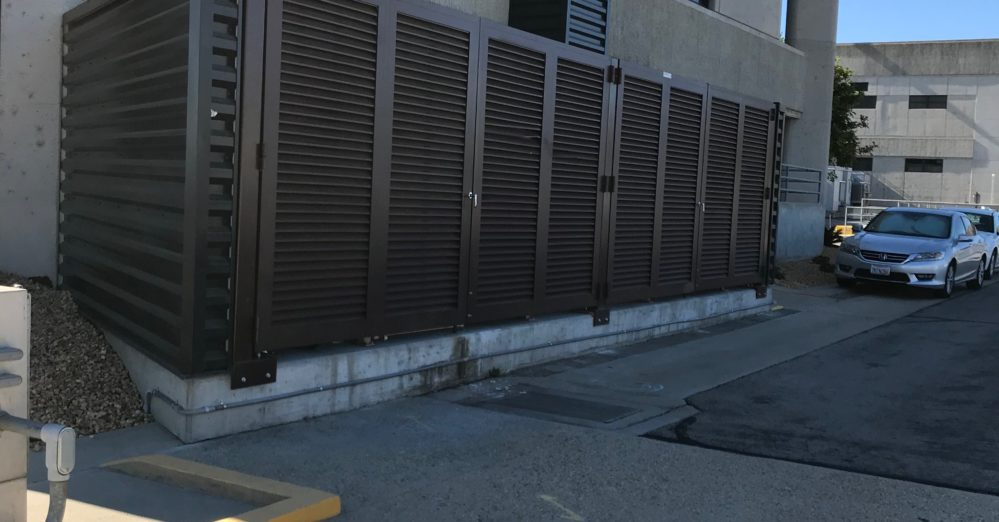 A PalmSHIELD brown louvered fence installed on the side of a Los Angeles building