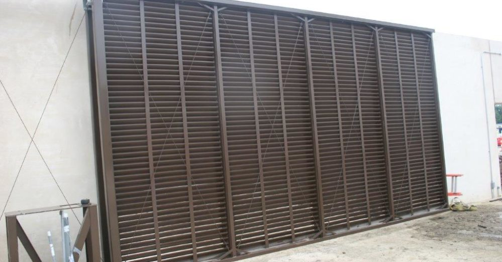 Dark brown horizontal louver slide gate