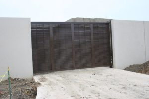 Chocolate brown architectural louvered slide gate
