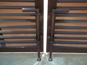 Two drop rods on an industrial louvered gate