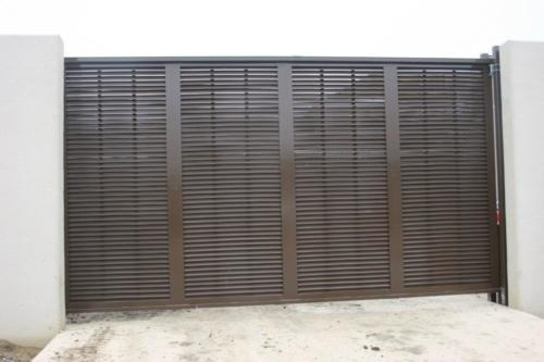 Louvered architectural industrial cantilever gate