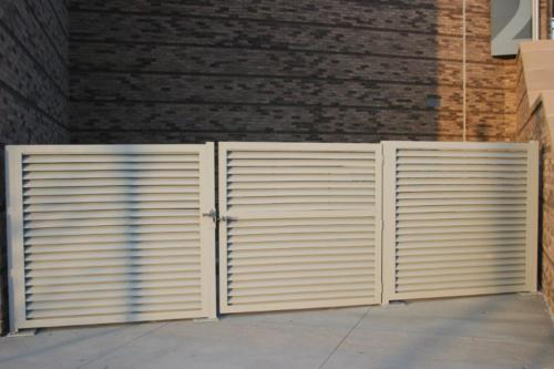 Custom louvered commercial swing gate